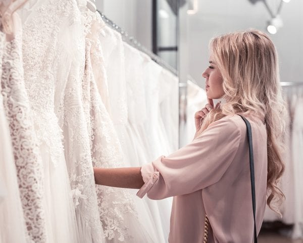 Bride choosing a wedding dress